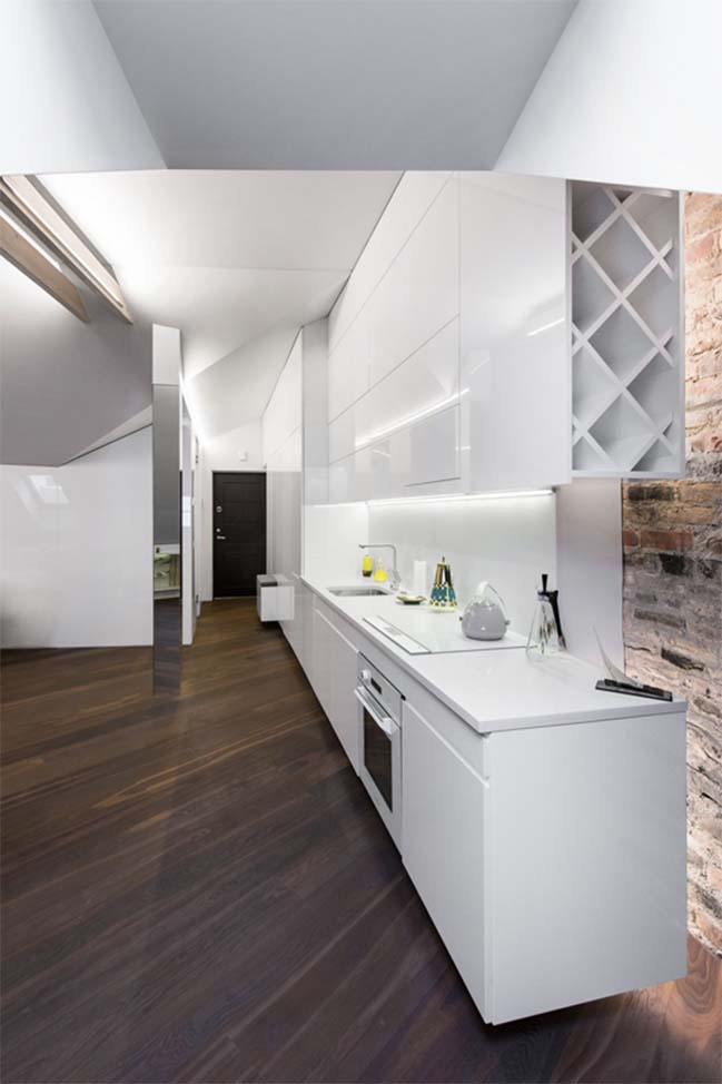 Modern attic apartment by YCL