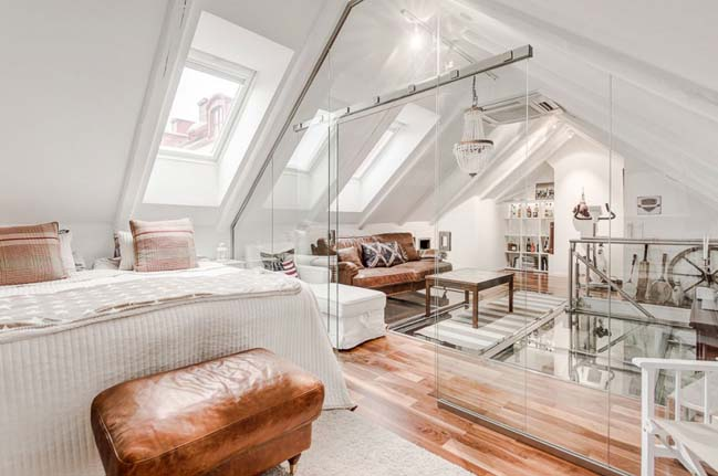 Scandinavian attic with glass floor in Sweden