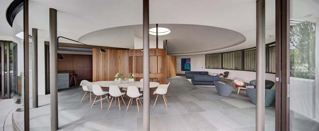 Hill house with circular structure by Tzannes Associates