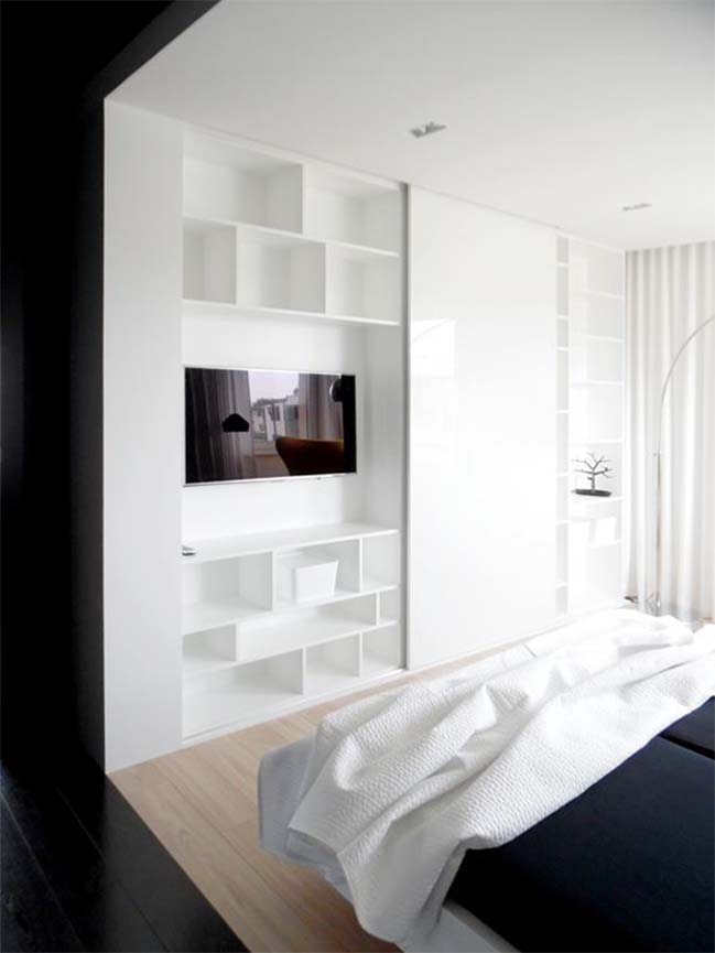 Modern apartment with combination of white and wood