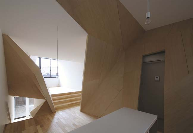 Modern townhouse with polyhedral walls