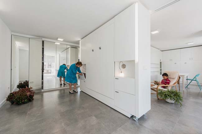 Modern apartment with rotating walls by PKMN Architecture