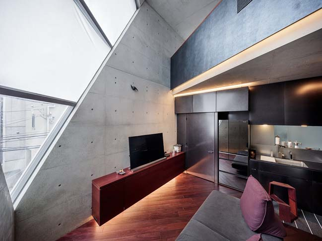 Concrete townhouse with unique futuristic architecture