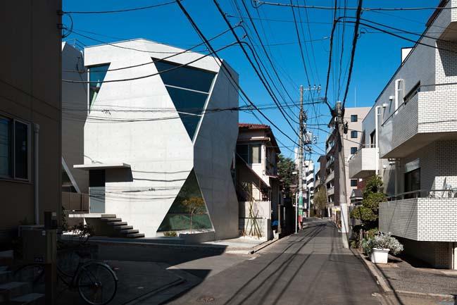 Concrete townhouse with unique futuristic architecture