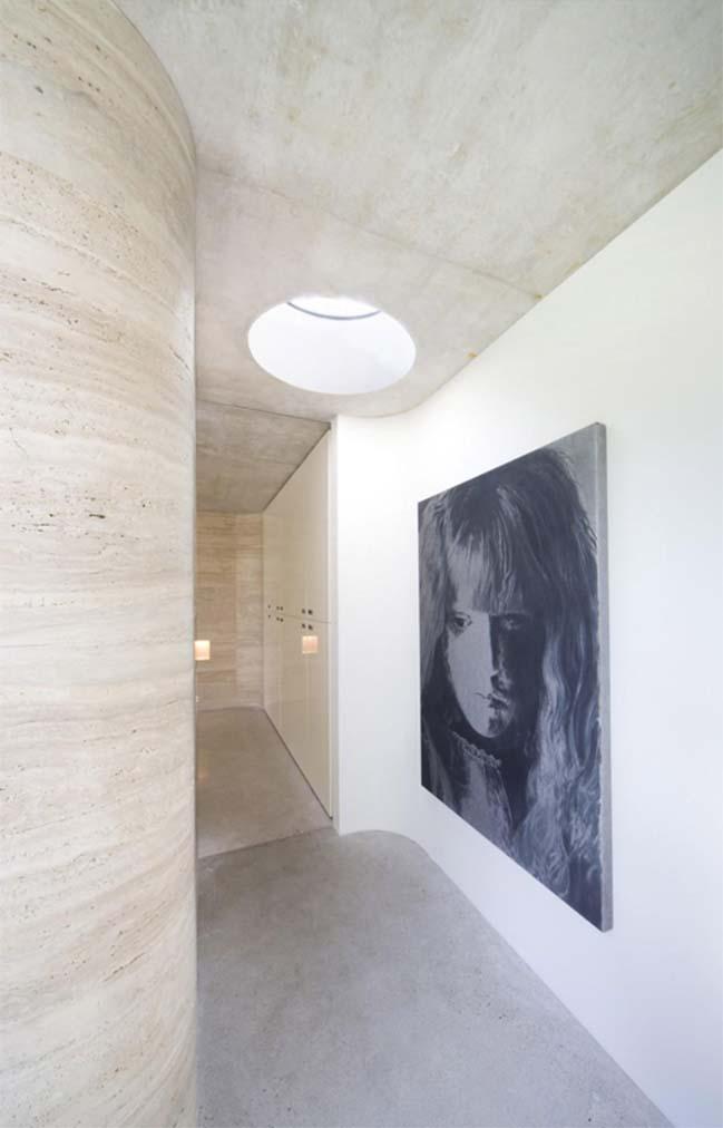 Concrete villa with glass walls by De Bever Architecten