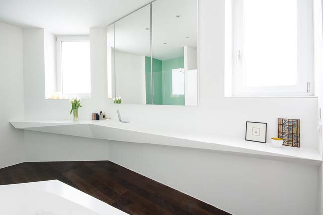 White bathroom design inspired by ice