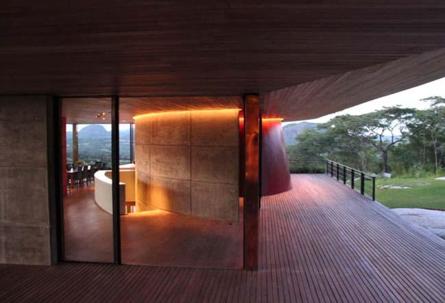 A dream house on a rock overlooking a man-made dam