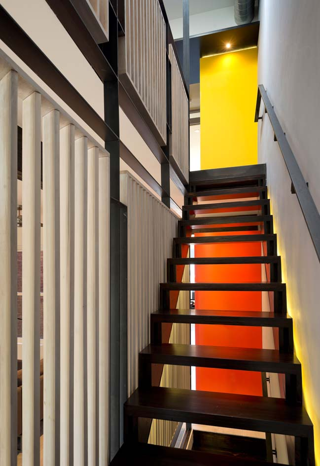 Light and colorful townhouse by KUBE Architecture