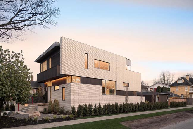 Modern house with white brick facade by RBA