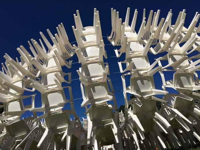 Recyclable Pavilion by 500 white plastic chairs by CODA