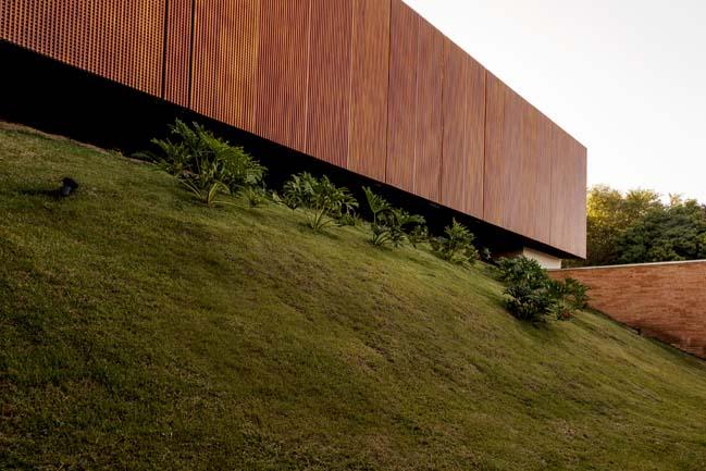 Luxury stone home by mf+arquitetos