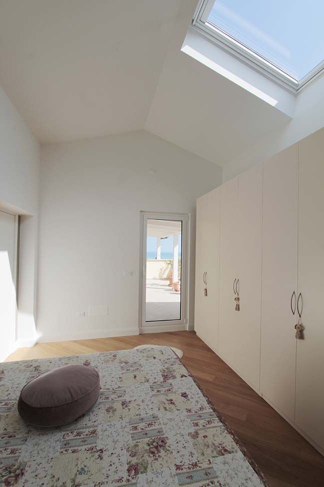Renovation of an attic in Italy by Moreno Farina Studio