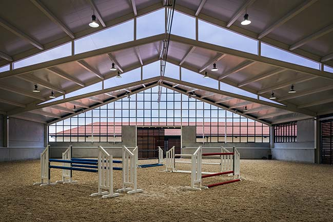 Horse Riding Field in Cattle Farm by OOIIO Architecture
