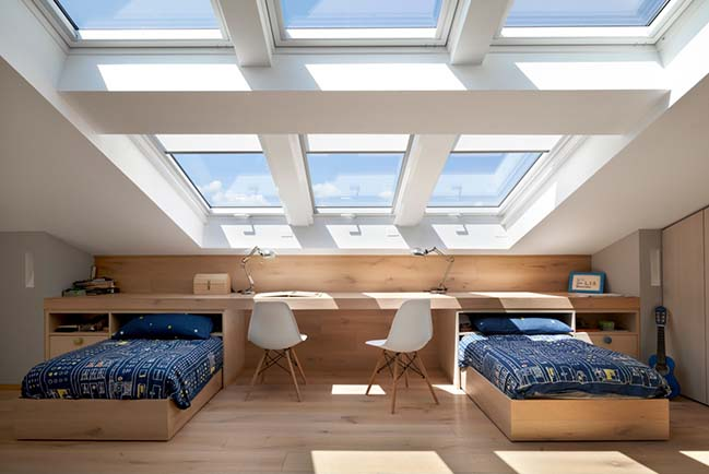 Attic renovation with skylights opening by BIONDI Architetti