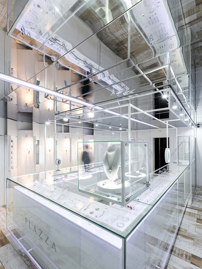 PLAZZA - Jewelry and watchmaking store by EFEEME arquitectos