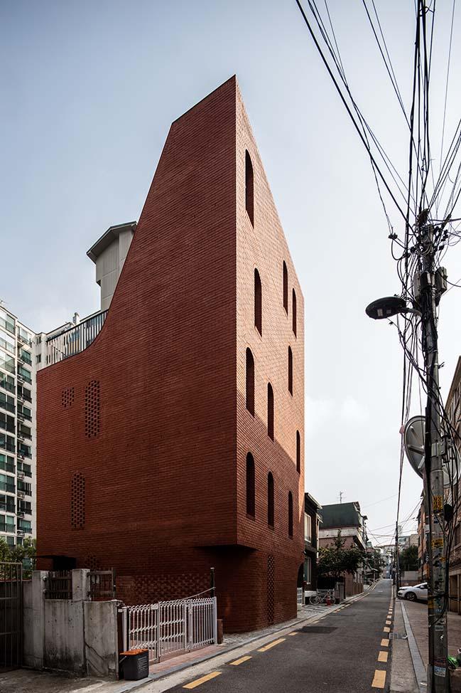 Brick five-story house in Seoul by stpmj