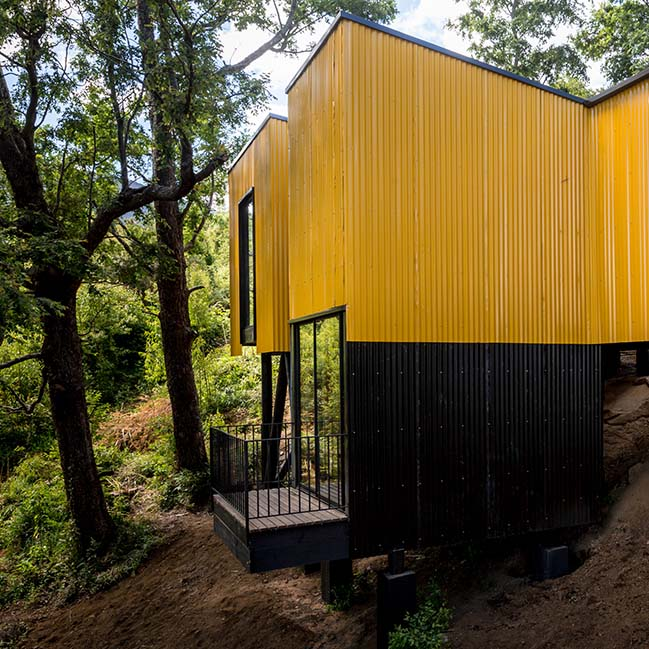 Yellow House in Pucon by Alejandro Soffia