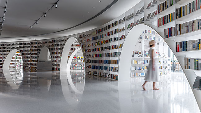 Books over the clouds by Wutopia Lab